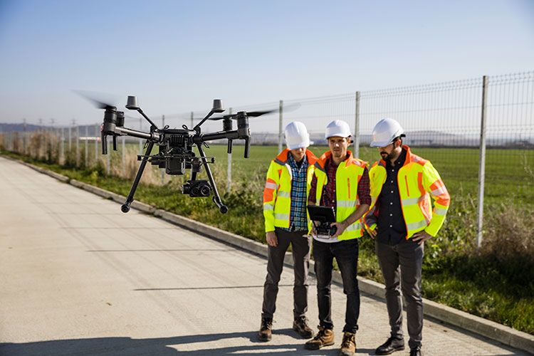 Drone Program - Drone Integration Course - Industry workers flying drone at construction site