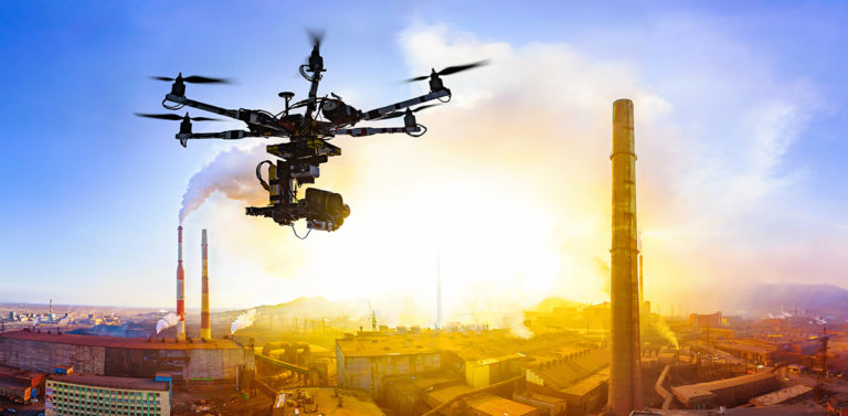 Drone flying in the sky - debunking the myths about drones - Consortiq