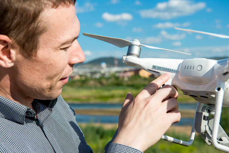 UK drone industry - man holding drone