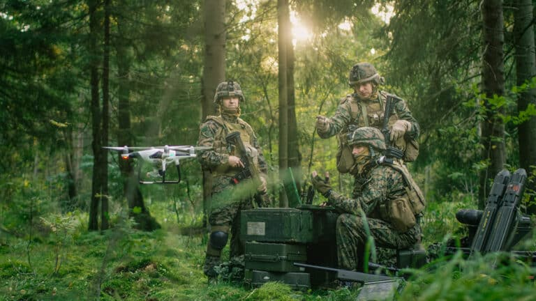 military drones - military team operating a drone