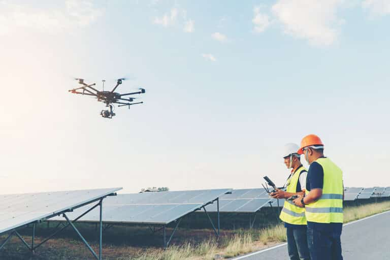 6 industries that are using drones - workers flying drones over solar panels
